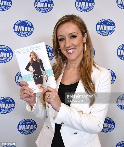 CoHost Megan Alexander shows her new book 'Faith in the Spotlight' during the 2016 Inspirational Country Music Association Awards at Trinity Music...
