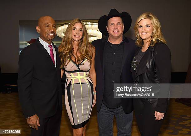 Cohost Montel Williams Tara Fowler host Garth Brooks and host Trisha Yearwood attend the ACM Lifting Lives Gala at the Omni Hotel on April 17 2015 in...