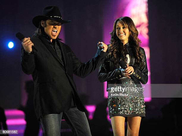 Co-Host Musician/actors Billy Ray Cyrus and Miley Cyrus speak onstage during the 2008 CMT Music Awards at the Curb Event Center at Belmont University...