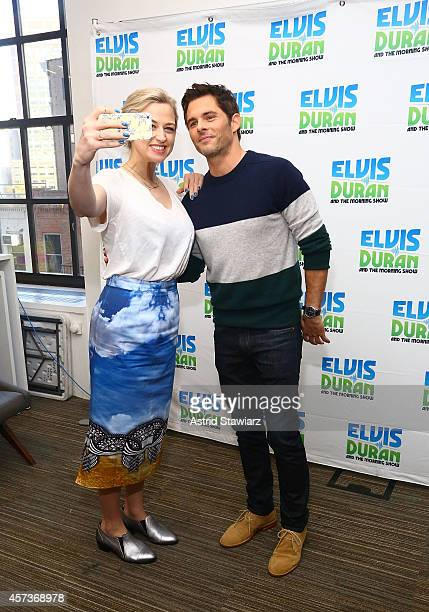"""Co-host of Elvis Duran & the Morning Show, Bethany Watson and actor James Marsden take a selfie during the """"Elvis Duran's Z100 Morning Show"""" at Z100..."""