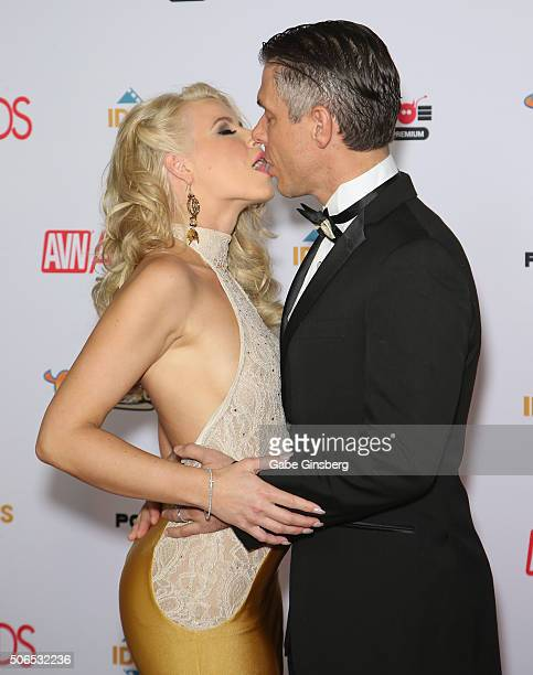 Cohost of the 2016 Adult Video News Awards adult film actress Anikka Albrite kisses her husband adult film actor/director Mick Blue as they attend...