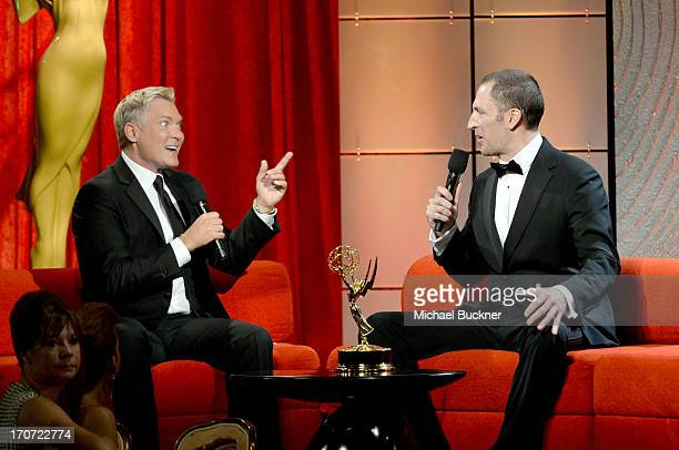Cohost Sam Champion and tv personality Ben Bailey speak onstage during the 40th Annual Daytime Emmy Awards at the Beverly Hilton Hotel on June 16...