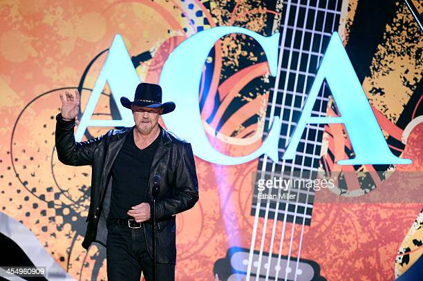 Co-host Trace Adkins speaks onstage during the American Country Awards 2013 at the Mandalay Bay Events Center on December 10, 2013 in Las Vegas,...