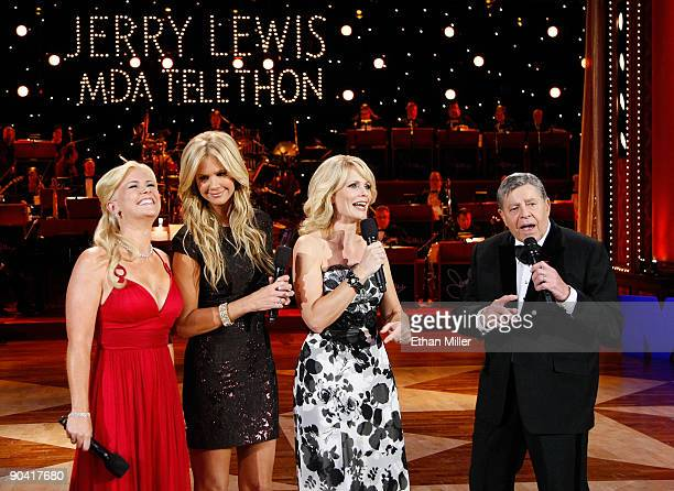 Cohosts Alison Sweeney Nancy O'Dell and Jann Carl and entertainer Jerry Lewis speak during the 44th annual Labor Day Telethon to benefit the Muscular...