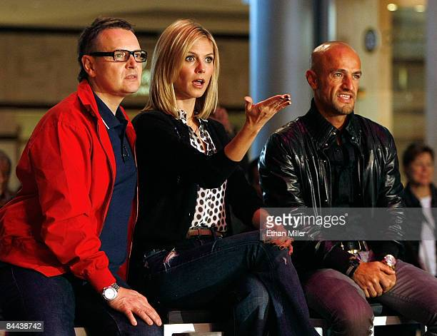 Cohosts and judges of 'Germany's Next Topmodel' Rolf Scheider model Heidi Klum and Peyman Amin watch contestants put on a fashion show during a...