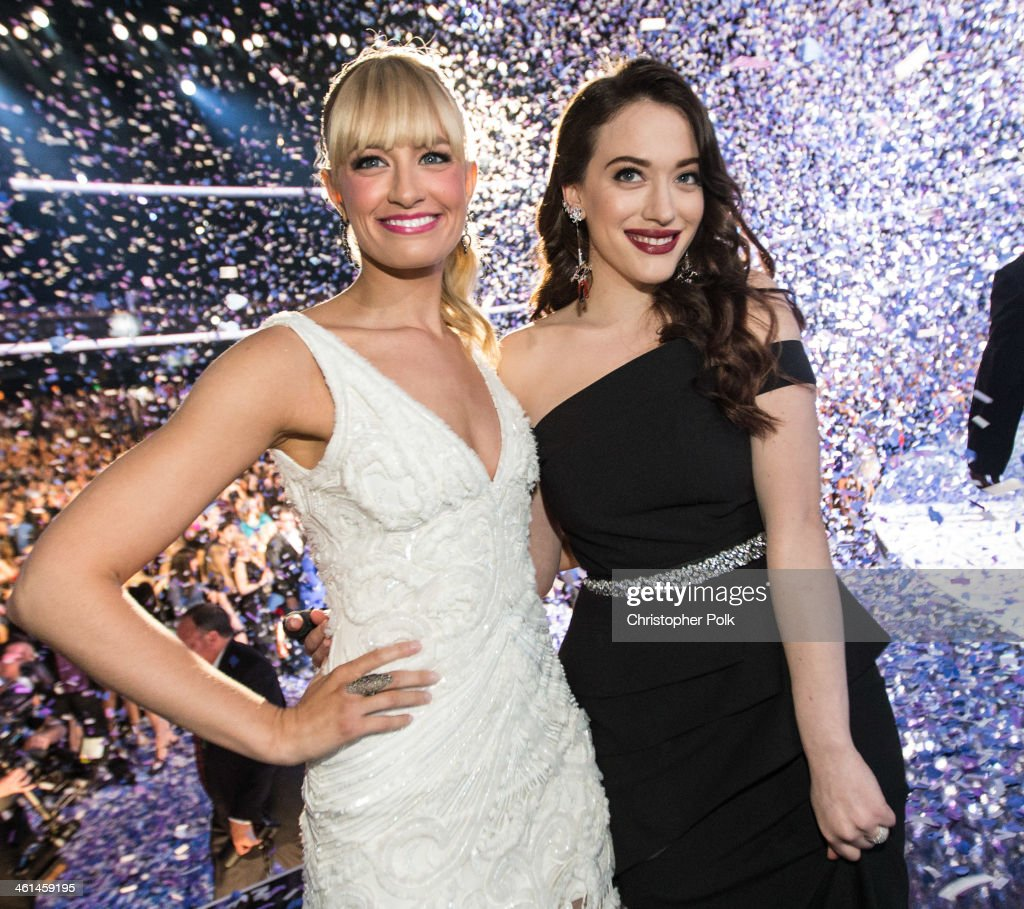 Co-hosts Beth Behrs (L) and Kat Dennings pose onstage during The 40th Annual People's Choice Awards at Nokia Theatre L.A. Live on January 8, 2014 in Los Angeles, California.