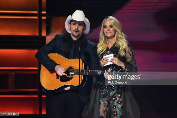 Cohosts Brad Paisley and Carrie Underwood speak onstage at the 51st annual CMA Awards at the Bridgestone Arena on November 8 2017 in Nashville...