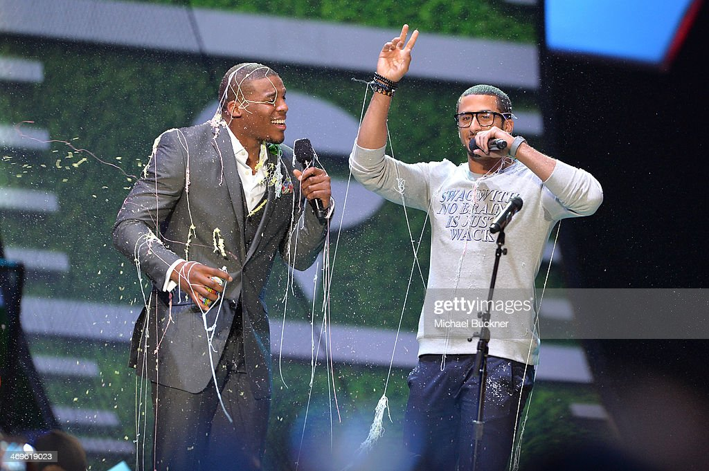 Co-hosts Cam Newton (L) and Colin Kaepernick speak onstage during Cartoon Network's fourth annual Hall of Game Awards at Barker Hangar on February 15, 2014 in Santa Monica, California.