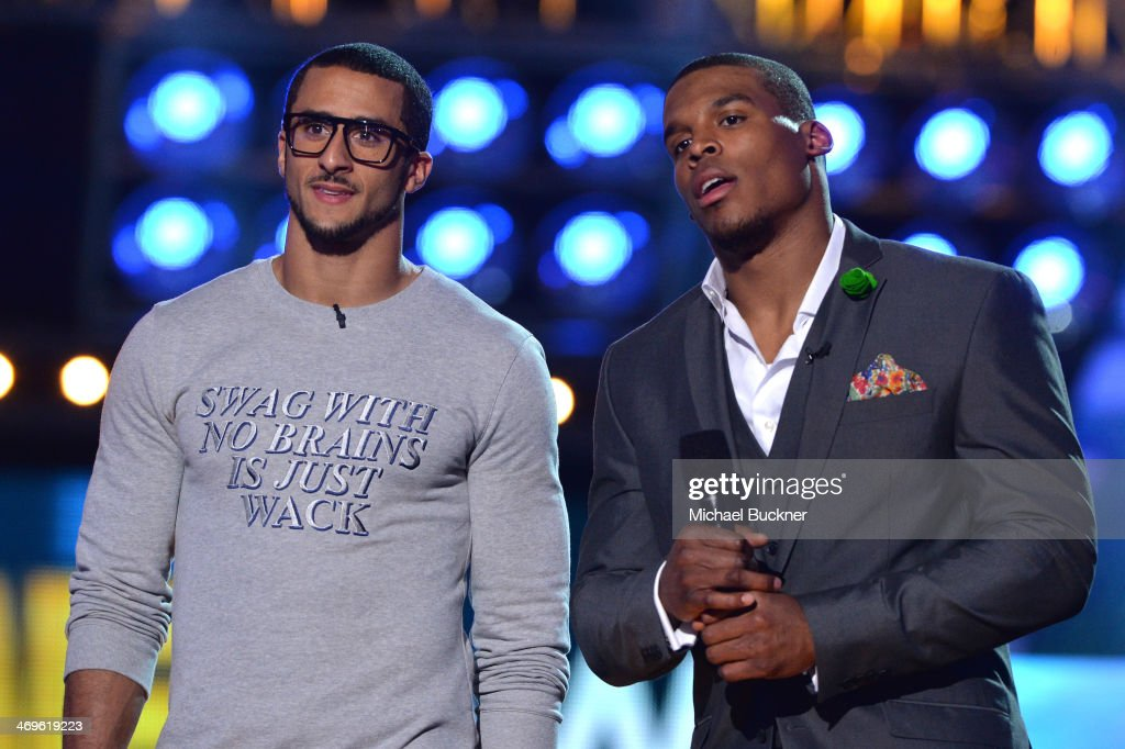 Co-hosts Cam Newton (R) and Colin Kaepernick speak onstage during Cartoon Network's fourth annual Hall of Game Awards at Barker Hangar on February 15, 2014 in Santa Monica, California.