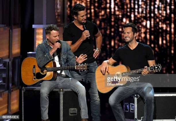 Cohosts Dierks Bentley and Luke Bryan speak as a wax figure of Luke Bryan is displayed onstage during the 52nd Academy of Country Music Awards at...