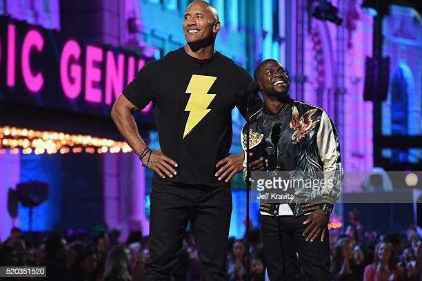 Cohosts Dwayne Johnson and Kevin Hart announce the award for Comedic Genius onstage during the 2016 MTV Movie Awards at Warner Bros Studios on April...