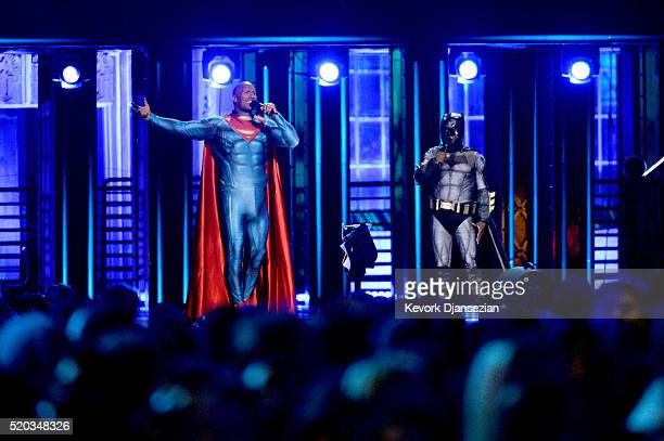 Cohosts Dwayne Johnson and Kevin Hart appear as Superman and Batman onstage during the 2016 MTV Movie Awards at Warner Bros Studios on April 9 2016...