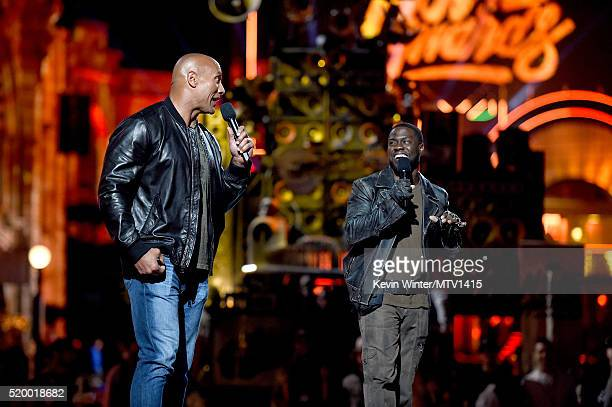 Cohosts Dwayne Johnson and Kevin Hart speak onstage during rehearsals for the 2016 MTV Movie Awards at Warner Bros Studios on April 8 2016 in Burbank...