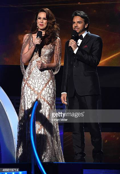 Cohosts Jacqueline Bracamontes and Eugenio Derbez speak onstage during the 15th Annual Latin GRAMMY Awards at the MGM Grand Garden Arena on November...