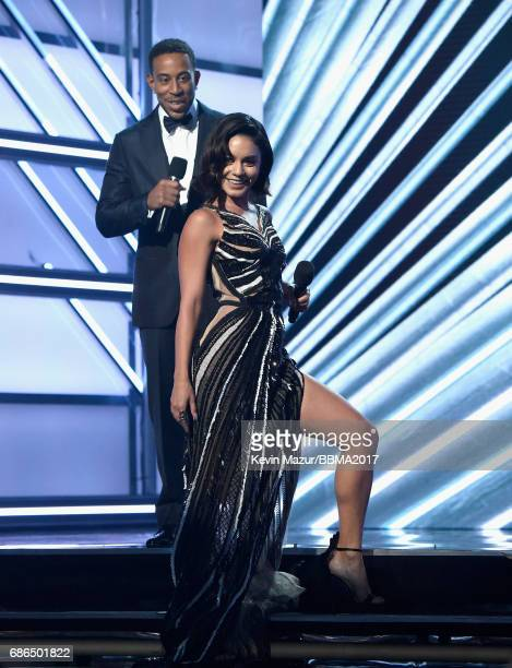Cohosts Ludacris and Vanessa Hudgens speak onstage during the 2017 Billboard Music Awards at TMobile Arena on May 21 2017 in Las Vegas Nevada