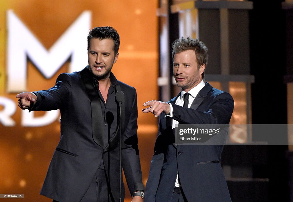 Co-hosts Luke Bryan (L) and Dierks Bentley speak onstage during the 51st Academy of Country Music Awards at MGM Grand Garden Arena on April 3, 2016 in Las Vegas, Nevada.