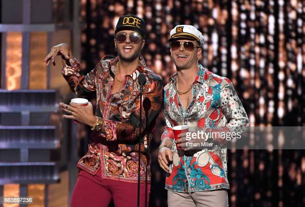 Cohosts Luke Bryan and Dierks Bentley speak onstage during the 52nd Academy of Country Music Awards at TMobile Arena on April 2 2017 in Las Vegas...