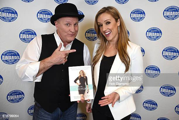 CoHosts Megan Alexander with Colin Raye poses with Megan Alexander's new book 'Faith in the Spotlight' during the 2016 Inspirational Country Music...
