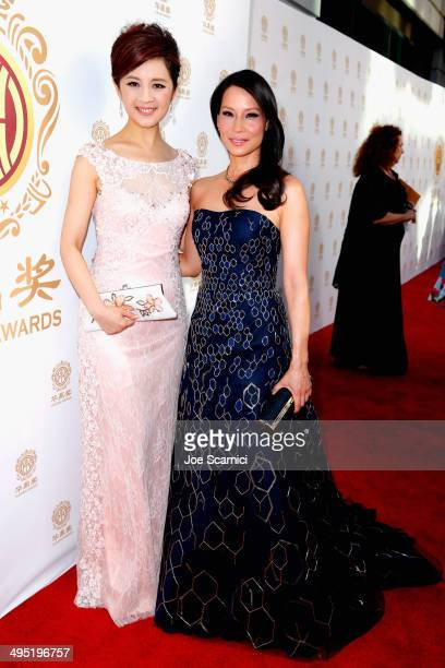 Co-Hosts Olivia Xu and Lucy Liu attend the Huading Film Awards on June 1, 2014 at Ricardo Montalban Theatre in Los Angeles, California. Huading Film...