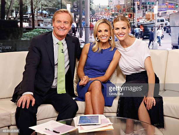 Cohosts Steve Doocy and Elisabeth Hasselbeck pose with actress Brooklyn Decker during her visit to Fox and Friends at FOX Studios on September 3 2014...