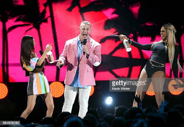 Cohosts Victoria Justice and John Cena and actress Laverne Cox speak onstage during Teen Choice Awards 2016 at The Forum on July 31 2016 in Inglewood...