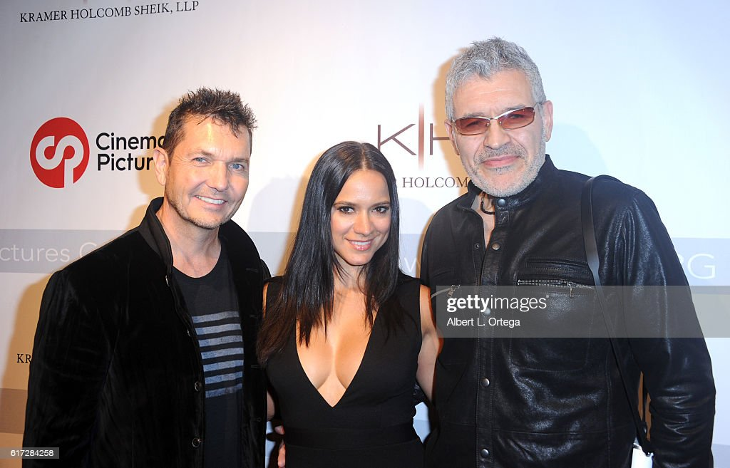 Co-hosts/photgraphers T.J. Scott and Dennys Ilic with actress Luciana Faulhaber at the Launch Of Cinematic Pictures Gallery held at Hollywood And Highland Center on October 21, 2016 in Los Angeles, California.