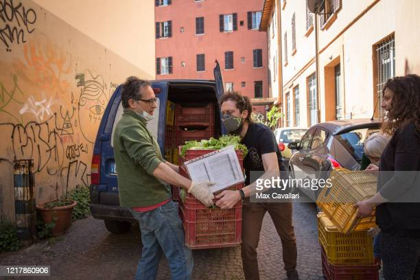 A cohousing in downtown distributes vegetables from biological farms to residents on April 09 2020 in Bologna Italy There have been well over 100000...