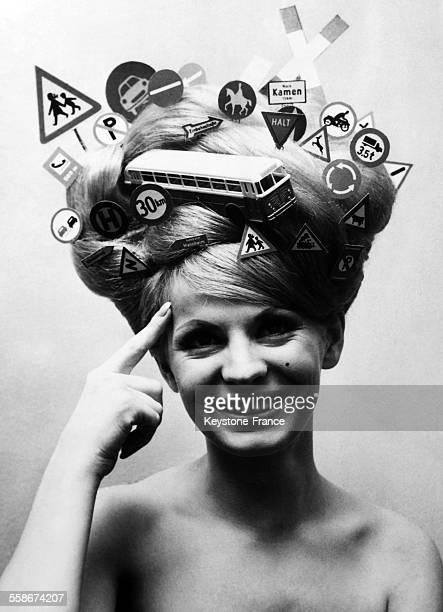 Coiffure de la reine du code routier realisee par Adriano celebre coiffeur de Francfort le 2 fevrier 1965