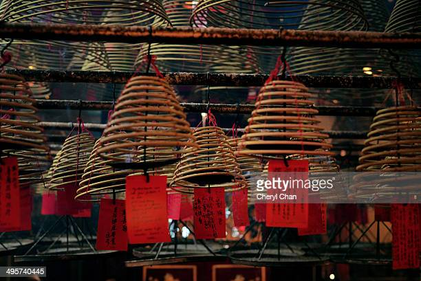 coil incense with blessings - incense coils stock pictures, royalty-free photos & images