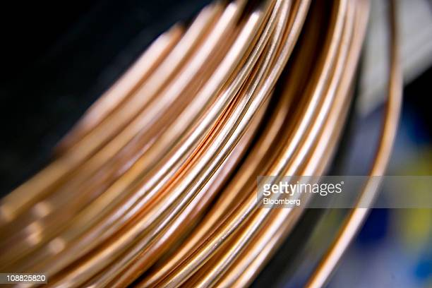 A coil of copper ground wire is displayed for a photograph in a hardware store in Princeton Illinois US on Friday Feb 4 2011 Copper extended a rally...