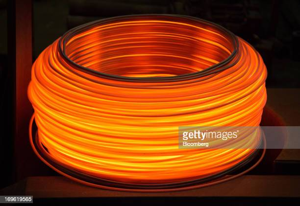 A coil of red hot wire rod cools at the Oskol Elektrometallurgical Plant steel mill operated by Metalloinvest Holding Co in Stary Oskol Russia on...