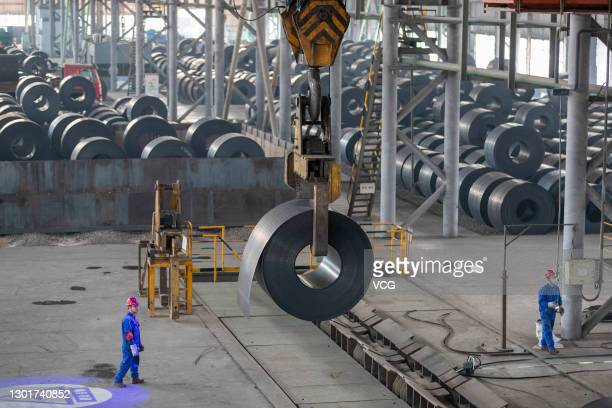 Coil of steel is lifted at a factory of Shanxi Jianlong Industry Co. Ltd on February 11, 2021 in Yuncheng, Shanxi Province of China.