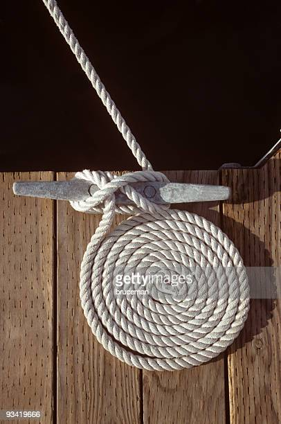 coiled mooring line - cleats stock pictures, royalty-free photos & images
