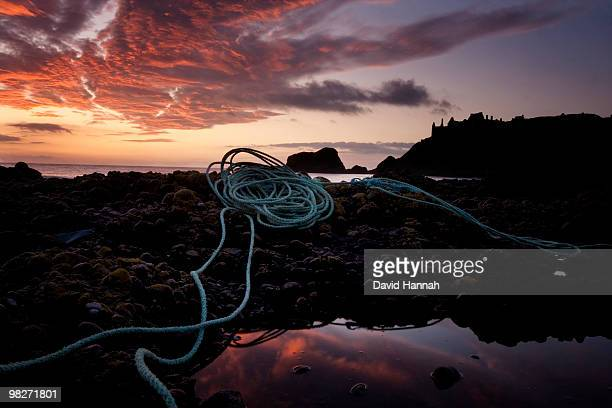 coiled on the dark rocks - dunnottar castle - 2000 2009 stock pictures, royalty-free photos & images
