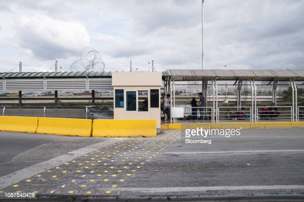Coiled razor wire fencing sits atop of the canopy next to a US Customs and Border Protection booth at the McAllenHidalgoReynosa International Bridge...