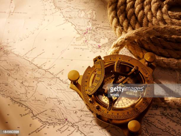 Coiled Rope and Nautical Chart with a Compass