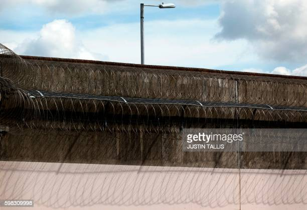 Coils of barbed wire are pictured on the walls inside Reading prison during an exhibition photocall at the prison in Reading west of London on...