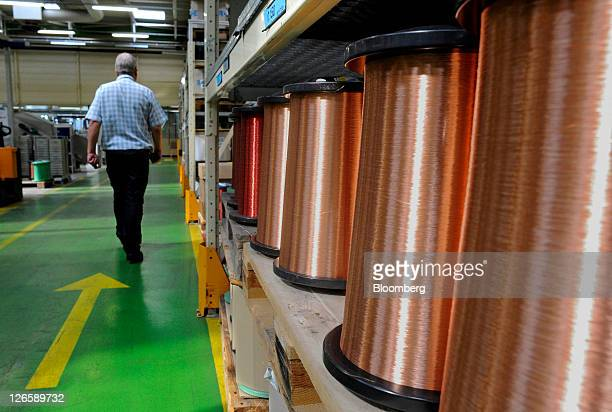 Coils of copper sit on the production line at Schneider Electric SA's factory in Le Vaudreuil France on Friday Sept 23 2011 Schneider Electric SA is...
