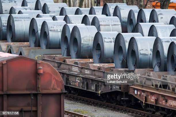 Coils of steel stand on trains in front of the ThyssenKrupp steel mill on March 5 2018 in Duisburg Germany Tensions between US President Donald Trump...