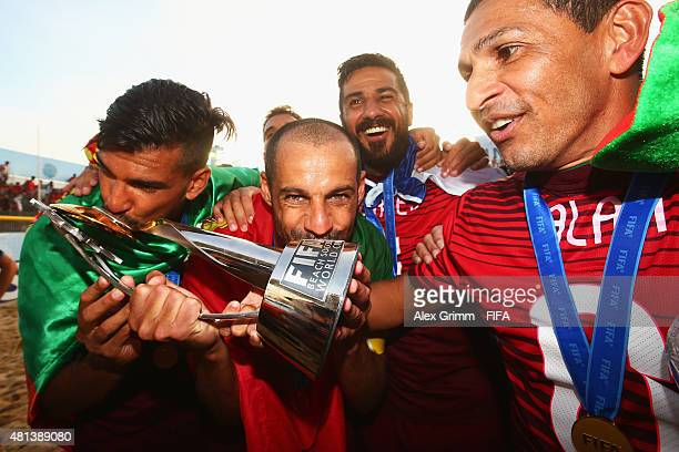 Coimbra, Madjer, Torres and Alan of Portugal celebrate with the trophy after winning the FIFA Beach Soccer World Cup Portugal 2015 Final between...