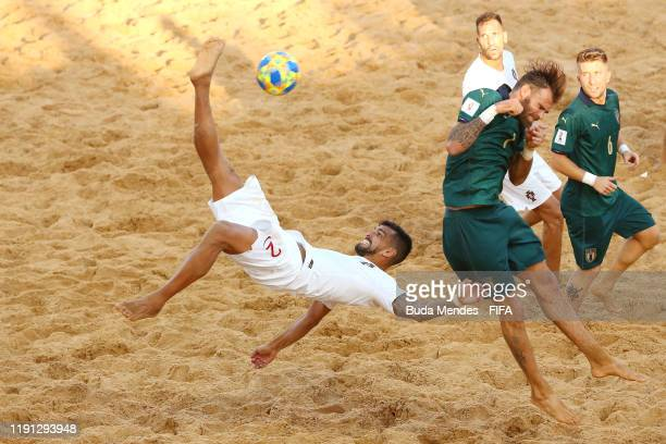 Coimbra of Portugal attempts an overhead kick under pressure from Dario Ramacciotti of Italy during the FIFA Beach Soccer World Cup Paraguay 2019...