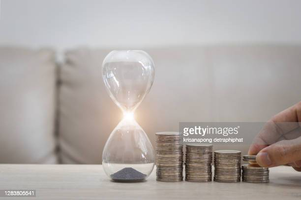 coin and hourglass,saving,money,business concept - urgency stock pictures, royalty-free photos & images