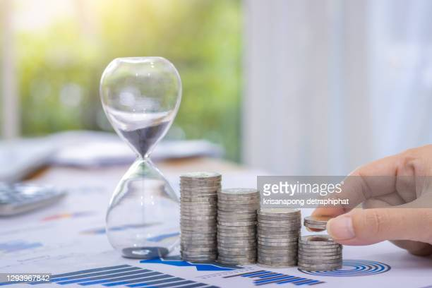coin and hourglass,saving,money,business concept - deadline stock pictures, royalty-free photos & images