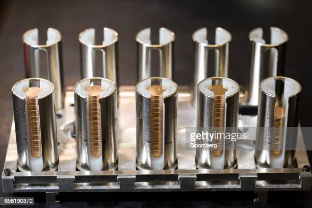 Coin 'blanks' sit in holders before being pressed in the production of gold bullion at The Royal Mint in Llantrisant UK on Thursday March 23 2017...