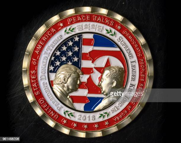 A coin for the upcoming USNorth Korea summit is seen in Washington DC on May 21 2018 A commemorative coin featuring US President Donald Trump and...