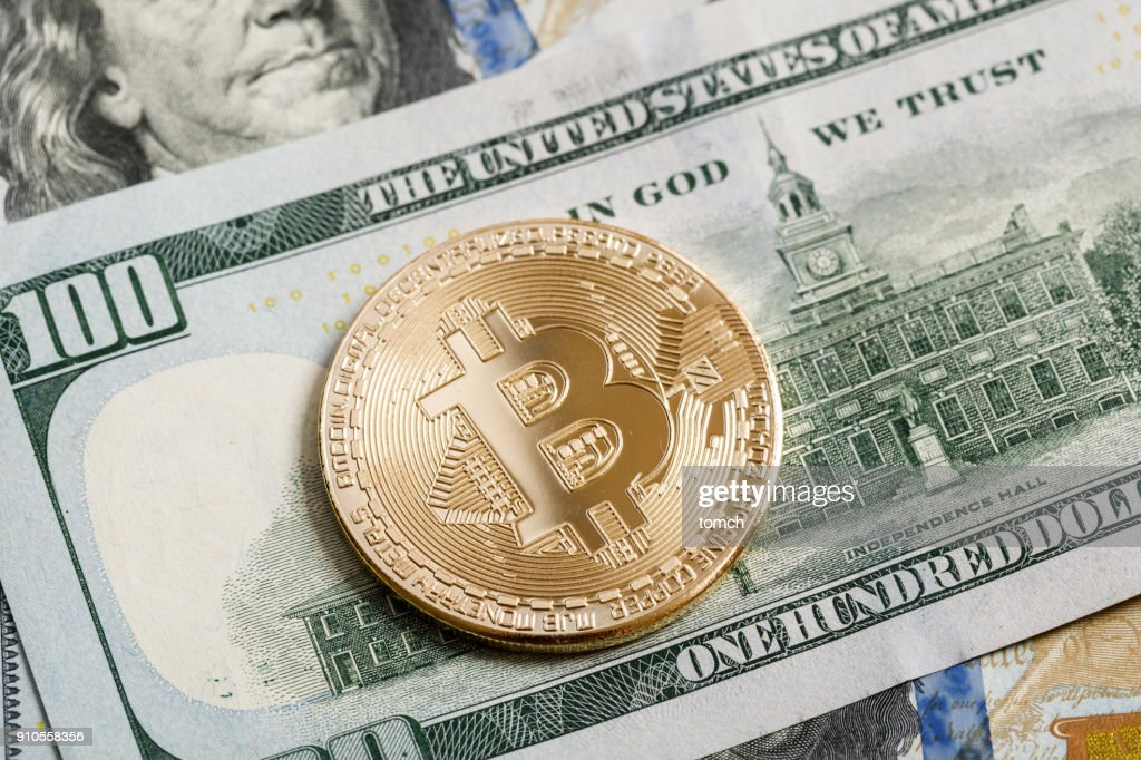 Coin In Shape Of Cryptocurrency Bitcoin On Top Us Dollars Is A Digital