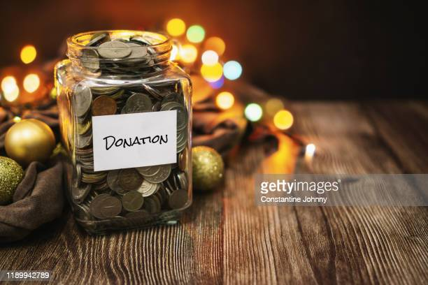 coin jar for collecting donation - donation box stock pictures, royalty-free photos & images