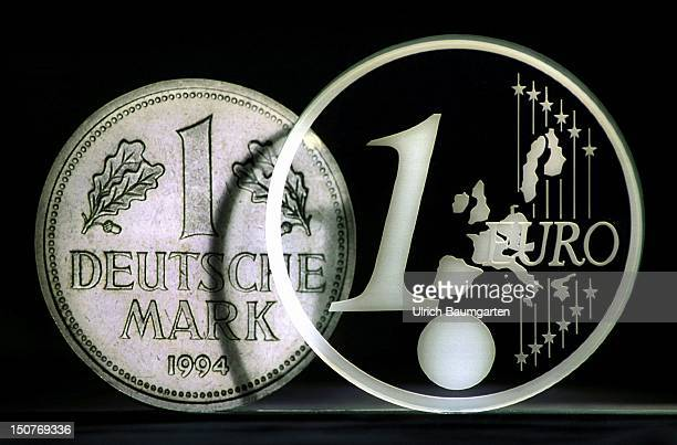 EURO coin made of glass and a 1 DM coin