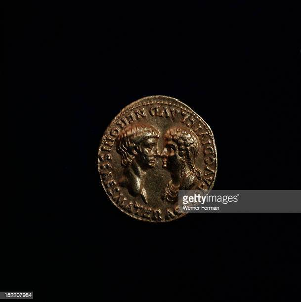 A coin minted in Rome showing busts of Nero and Agrippina facing On this coin Agrippinas names and titles are beside the heads while Neros appear in...