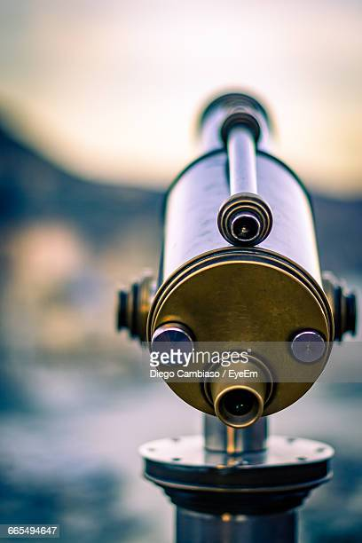 Coin Operated Binoculars Against Blurred Background
